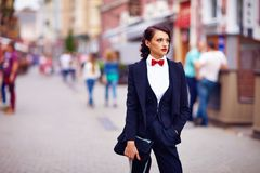 Beautiful elegant woman posing on crowded city street Royalty Free Stock Image