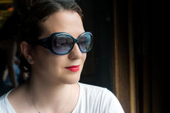 Beautiful Elegant Woman Posing with Sunglasses, reflecting Arist Stock Images
