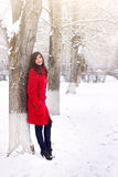 Beautiful elegant woman in red coat Royalty Free Stock Image