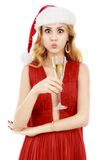 Beautiful elegant woman in red dress with a glass of champagne c Stock Photography