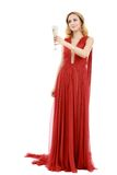 Beautiful elegant woman in red dress with a glass of champagne c. Elebrating Royalty Free Stock Photo