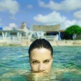Beautiful elegant woman in the sea. Photo of beautiful elegant woman in the sea at sunset Royalty Free Stock Image