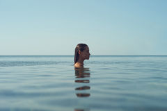 Beautiful elegant woman in the sea Royalty Free Stock Photos