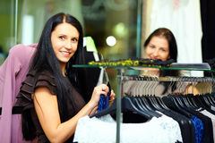 Beautiful elegant woman shopping in clothes store Royalty Free Stock Images