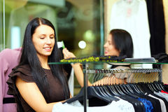 Beautiful elegant woman shopping in clothes store Stock Photography