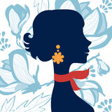 Beautiful  elegant woman silhouette. On floral background in vector format Royalty Free Stock Image