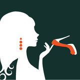 Beautiful elegant woman silhouette holding a shoe. Illustration  in vector format Stock Images