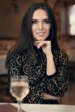 Beautiful Elegant Woman Sitting in a Restaurant Royalty Free Stock Photo