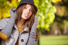 Beautiful elegant woman standing in a park Stock Photos