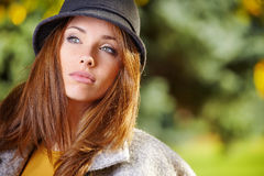 Beautiful elegant woman standing in a park Stock Photography
