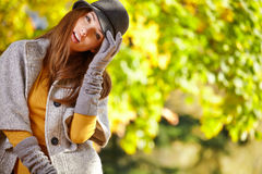 Beautiful elegant woman standing in a park Stock Image