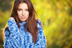 Beautiful elegant woman standing in a park in autumn Royalty Free Stock Photos