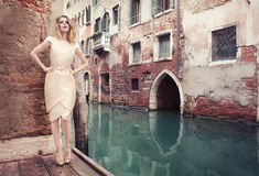 Beautiful, elegant woman in Venice, Italy. Beautiful, elegant woman near water canal, in Venice, Italy Stock Photography