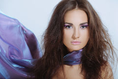 Beautiful elegant woman with violet color makeup and scarf on neck Royalty Free Stock Photos