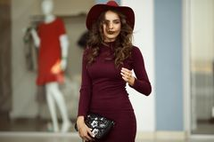 Beautiful elegant woman is wearing fashion autumn clothes with black bag, fall concept Royalty Free Stock Images