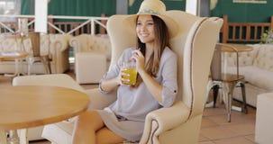 Stylish elegant woman having drink royalty free stock image