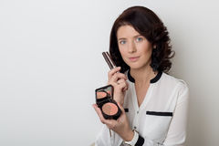 Beautiful Elegant Woman With Make-up Demonstrates The Decorative Cosmetic Products In Jars For Applying Makeup On A White Backgrou Stock Image
