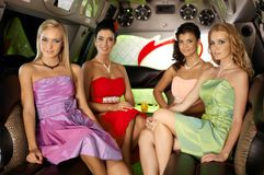 Beautiful elegant women in limousine Stock Image