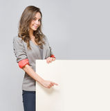 Elegant young businesswoman with blank white sign. Royalty Free Stock Photo