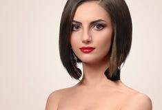 Beautiful elegant young woman posing in studio royalty free stock photos