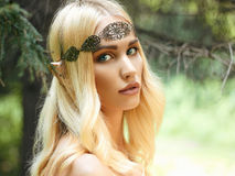 Beautiful elf girl in woods. Beautiful elf ears girl. fantasy young woman in woods stock image