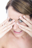 Beautiful Embarrassed Young Woman Peeping Through Fingers Royalty Free Stock Image