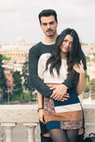 Beautiful embracing lovely young italian couple outdoors Royalty Free Stock Images
