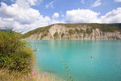 Beautiful emerald green water of Lake Castillon reflects the sky Royalty Free Stock Photo