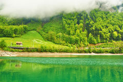 Beautiful emerald mountain lake in Switzerland Stock Photo