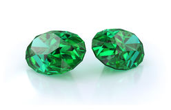 Beautiful emerald stones. Precious stones, two large, beautiful emeralds. 3d image. Light background Stock Photos