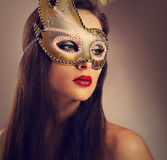 Beautiful emotion woman posing in carnival mask with bright make Stock Photo
