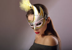 Beautiful emotion woman posing in carnival mask with red lipstic Stock Photos