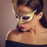 Beautiful emotion woman posing in fashion carnival mask with red Stock Photos