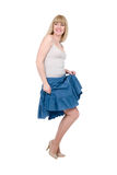 Beautiful emotional blonde in a dark blue skirt Stock Image