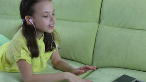 Beautiful emotional girl listening to song on stock footage