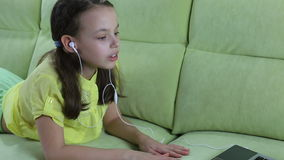 Beautiful emotional girl listening to song on stock video footage