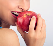 Beautiful emotional woman biting the red tasty apple. Part of be Royalty Free Stock Photos