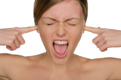 Beautiful emotional woman covers her ears with fingers Stock Photo
