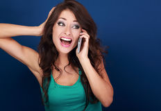 Beautiful emotional woman talking on mobile phone and loud shout Royalty Free Stock Photography