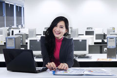 Beautiful employee smiling at camera Stock Photos