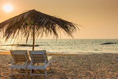 Beautiful empty beach and a pair of loungers Royalty Free Stock Photos