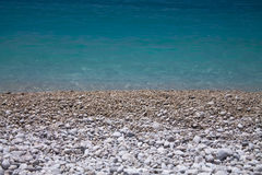 Beautiful empty beach pebbles with turquoise pure clear water in summertime with copy space background touristic destination, olud Stock Photography