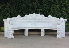 Beautiful white stone bench in the Park. Royalty Free Stock Photo