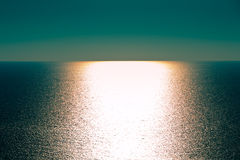 Beautiful empty ocean with a clear horizon. Waves on an empty ocean with sun reflections where you see a clear horizon Stock Image