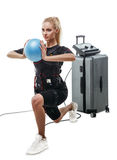 Beautiful EMS fitness woman doing lunge exercise with ball Royalty Free Stock Photography
