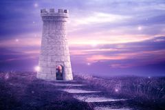 Magical Tower. Beautiful enchanted image with a castle tower and fireflies. Beautiful enchanted image with a castle tower and fireflies. Magical sky Royalty Free Stock Image