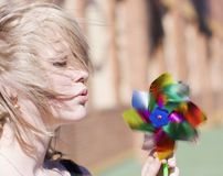 Beautiful Energy. From The Breath Of Lady Carries A Toy In Circular Motions Royalty Free Stock Photos
