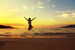 Beautiful energy young woman silhouette jumping on beautiful sun Royalty Free Stock Images