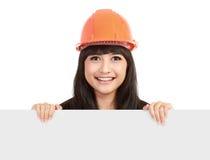 Beautiful engineer holding blank sheet Stock Image