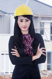 Beautiful engineer on site with yellow helmet. Beautiful engineer standing outdoor with yellow helmet Royalty Free Stock Image